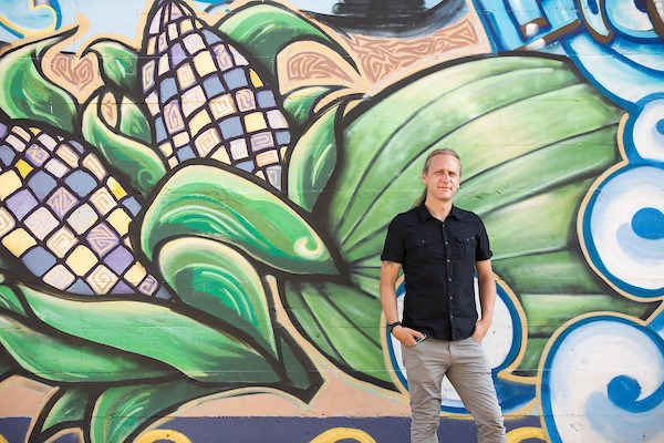 Image of Tyler Peterson in front of a mural in downtown Phoenix / Photo by Deanna Dent/ASU Now