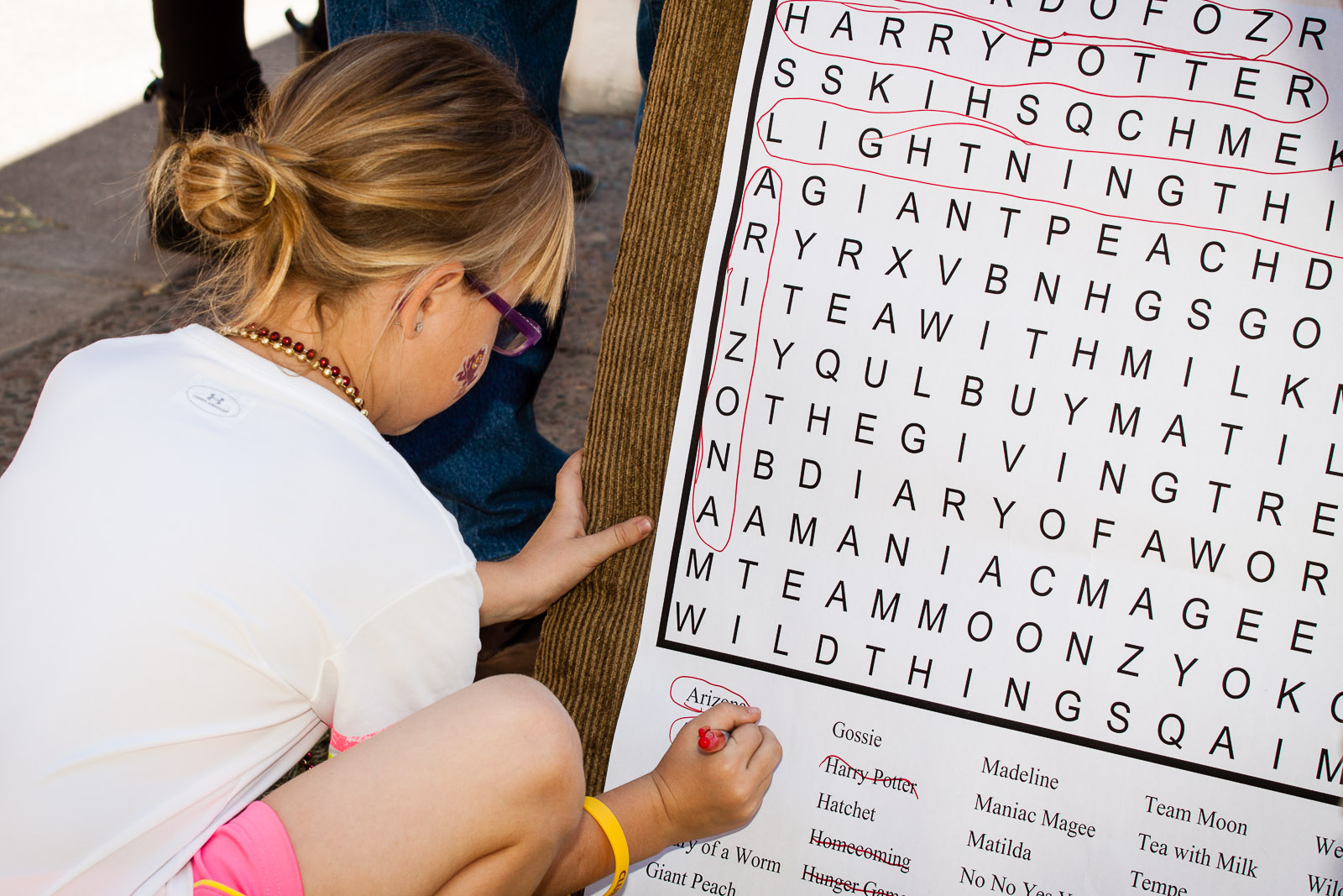 A Block Party participant fills in the giant word search. / Photo by Bruce Matsunaga.