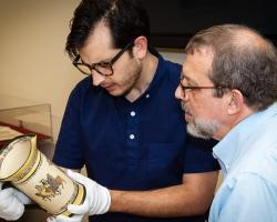 A student and professor Richard Newhauser examine an item in ASU Libraries' Special Collections.
