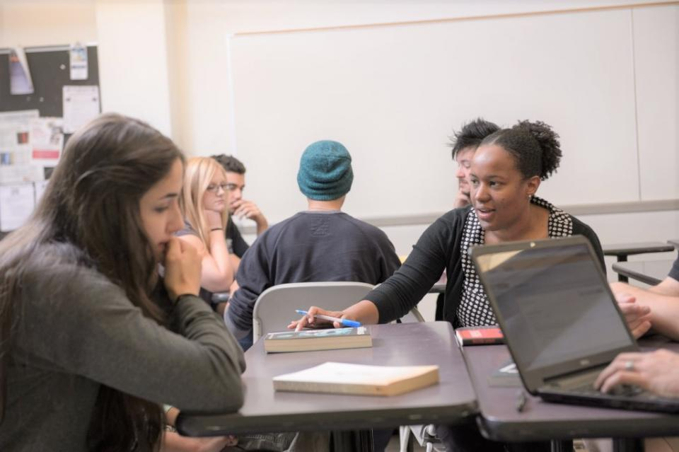Assistant Professor Sybil Durand (right) works with graduate students at ASU. / ASU photo