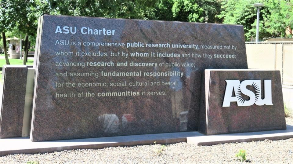ASU's charter is engraved into this monument that stands at the University Drive and College Ave entrance. ASU photo.