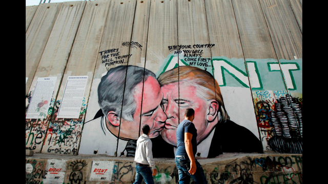 """""""The Deadly Kiss"""" on the Palestine wall / Photo by Sylvia Dahdal"""