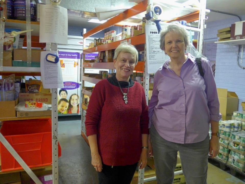 Karen Dwyer (right) and Adelheid Thieme (left) packing food boxes in the St. Vincent de Paul Society's pantry at Our Lady of Mt. Carmel Church. / Photo courtesy Adelheid Thieme