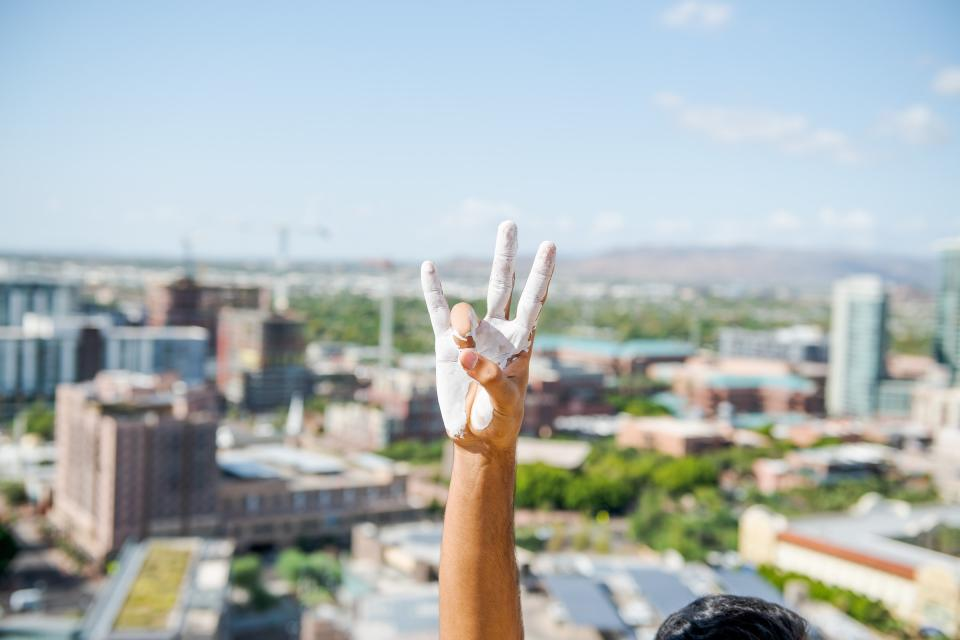 """A painted hand makes the pitchfork salute at ASU's 2019 """"Echo from the Buttes"""" event / Photo by Jared Opperman/ASU"""