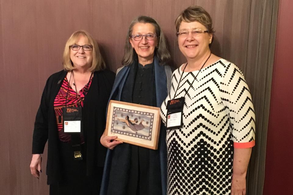 Image of Maureen Daly Goggin (left) and Shirley Rose (right) posing with Cathy Stevulak, director of 'Threads,' a documentary film shown at the conference. / Photo by Jennifer Russum