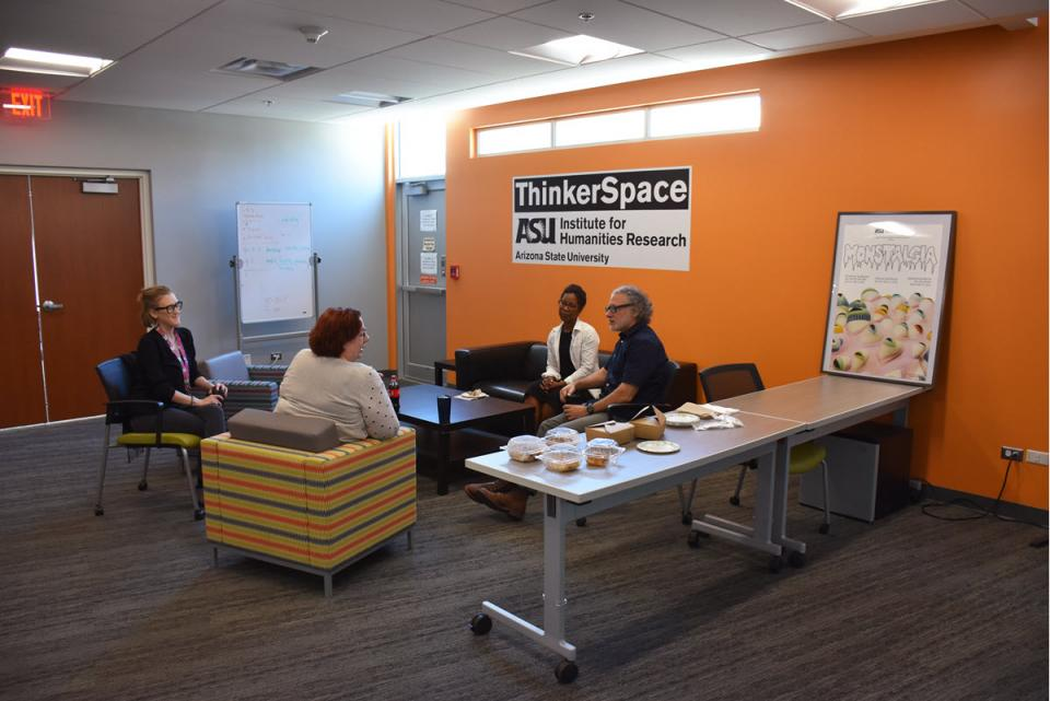 Faculty hold a meeting in the IHR's ThinkerSpace. / Photo courtesy the Institute for Humanities Research