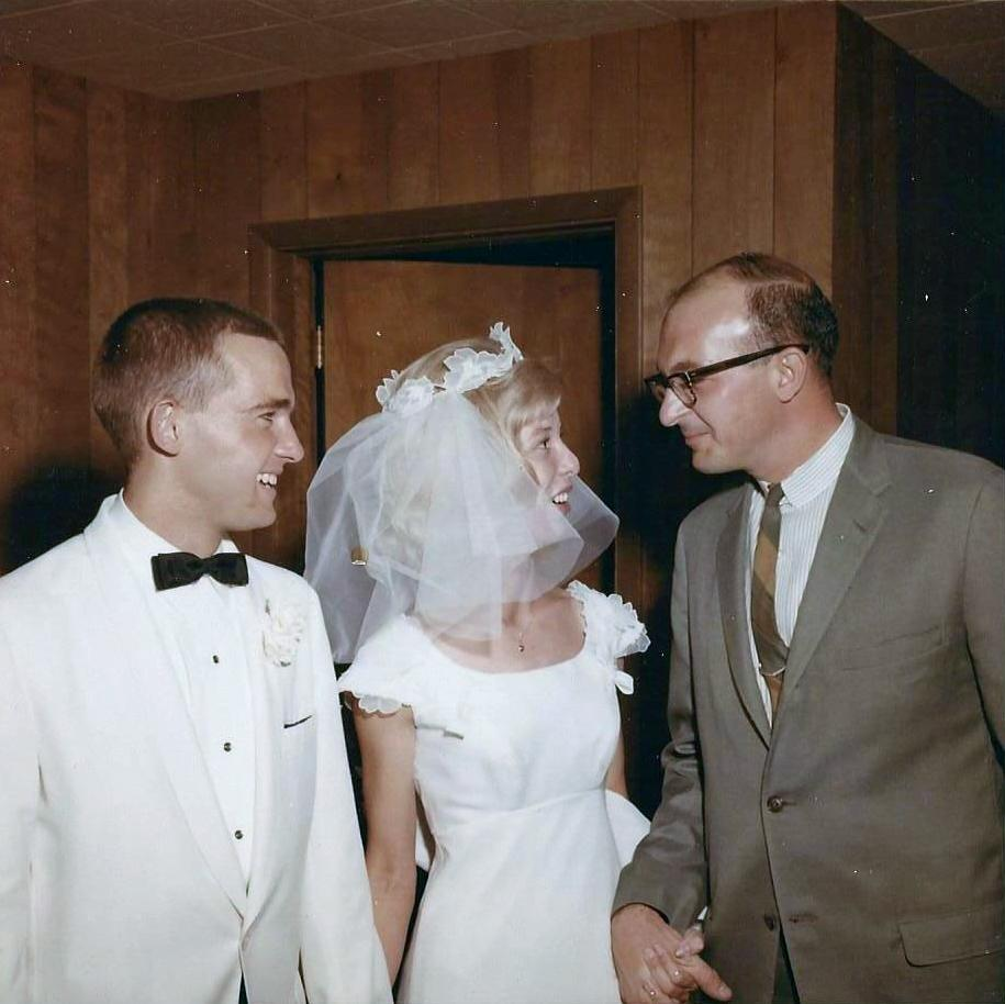 Jim and Karla Elling on their wedding day in 1965, being greeted by Karla's mentor and friend, Nick Salerno. / Photo courtesy Karla Elling.