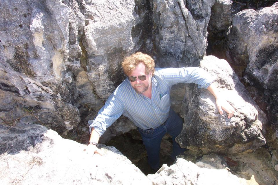 "Peter Goggin doing field work, exploring a sea cave in Bermuda called ""Jeffrey's Hole."" / Photo courtesy Goggin."