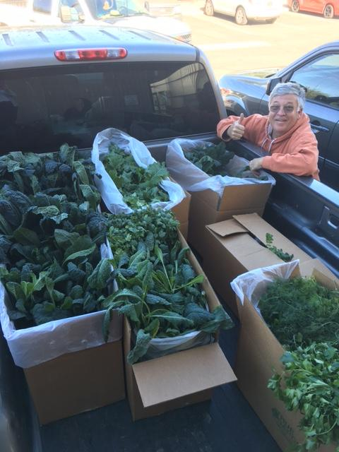 Paris Masek with a load of veggies grown by local farmers / Courtesy photo
