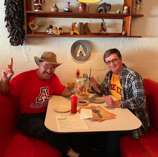 Courtesy photo of Jon Drnjevic and high school buddy Kevin Riley inside Tee Pee Mexican Restaurant in 2019.