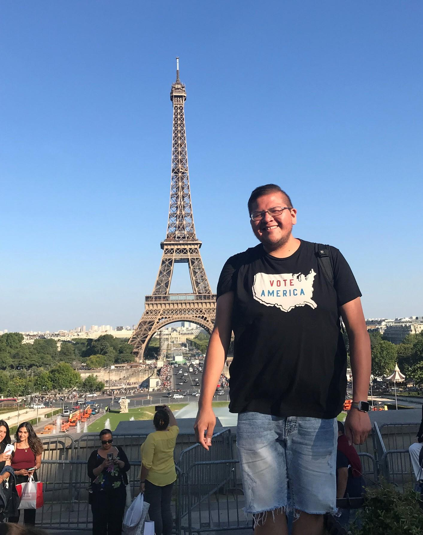 Courtesy photo of Michael Begay, who is standing in front of the Eiffel Tower in Paris.