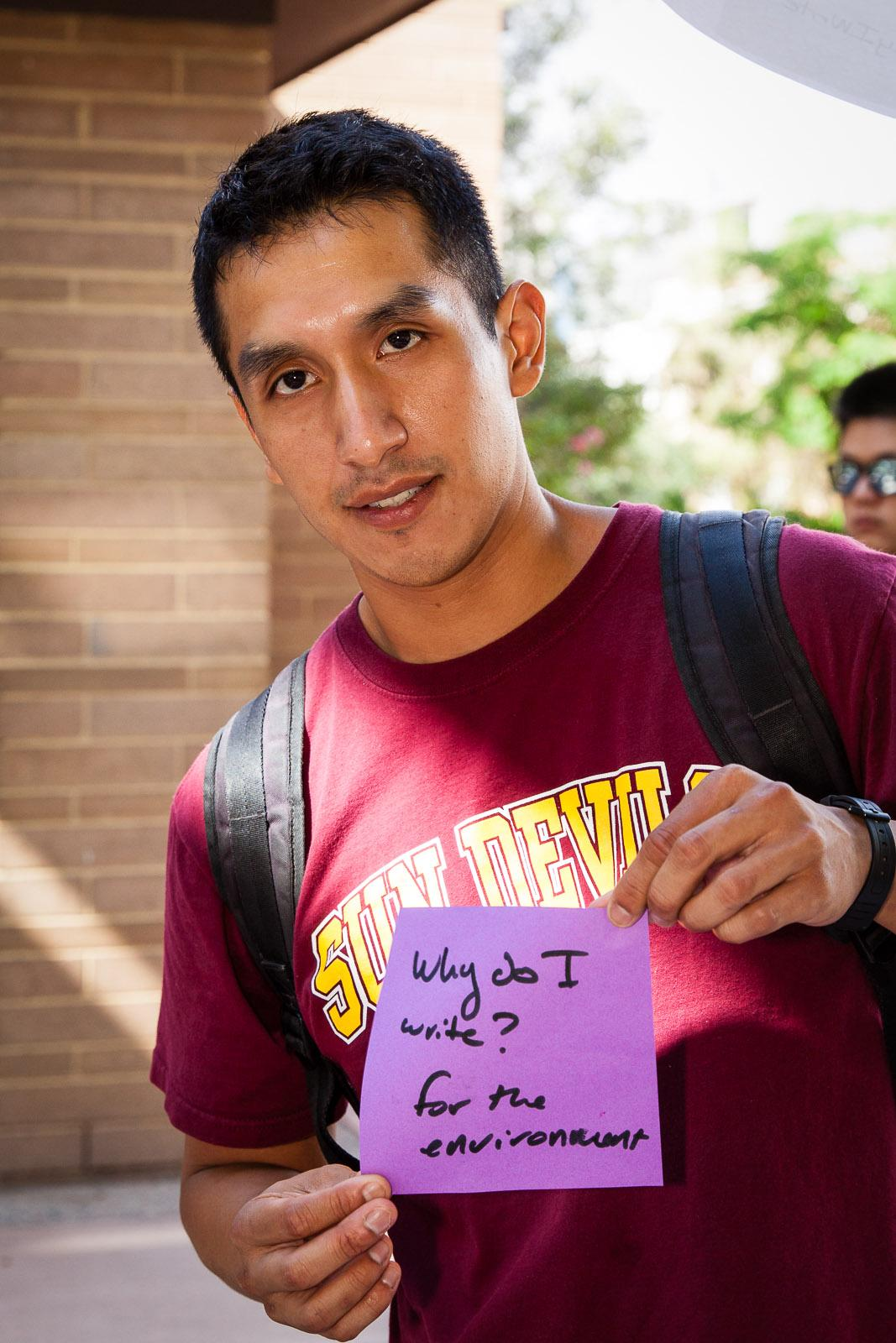 "Image: Students at ASU's celebration of the 2015 National Day on Writing articulated their thoughts on ""Why I Write."" This student discussed how writing helped his advocacy aims. / Photo by Bruce Matsunaga"