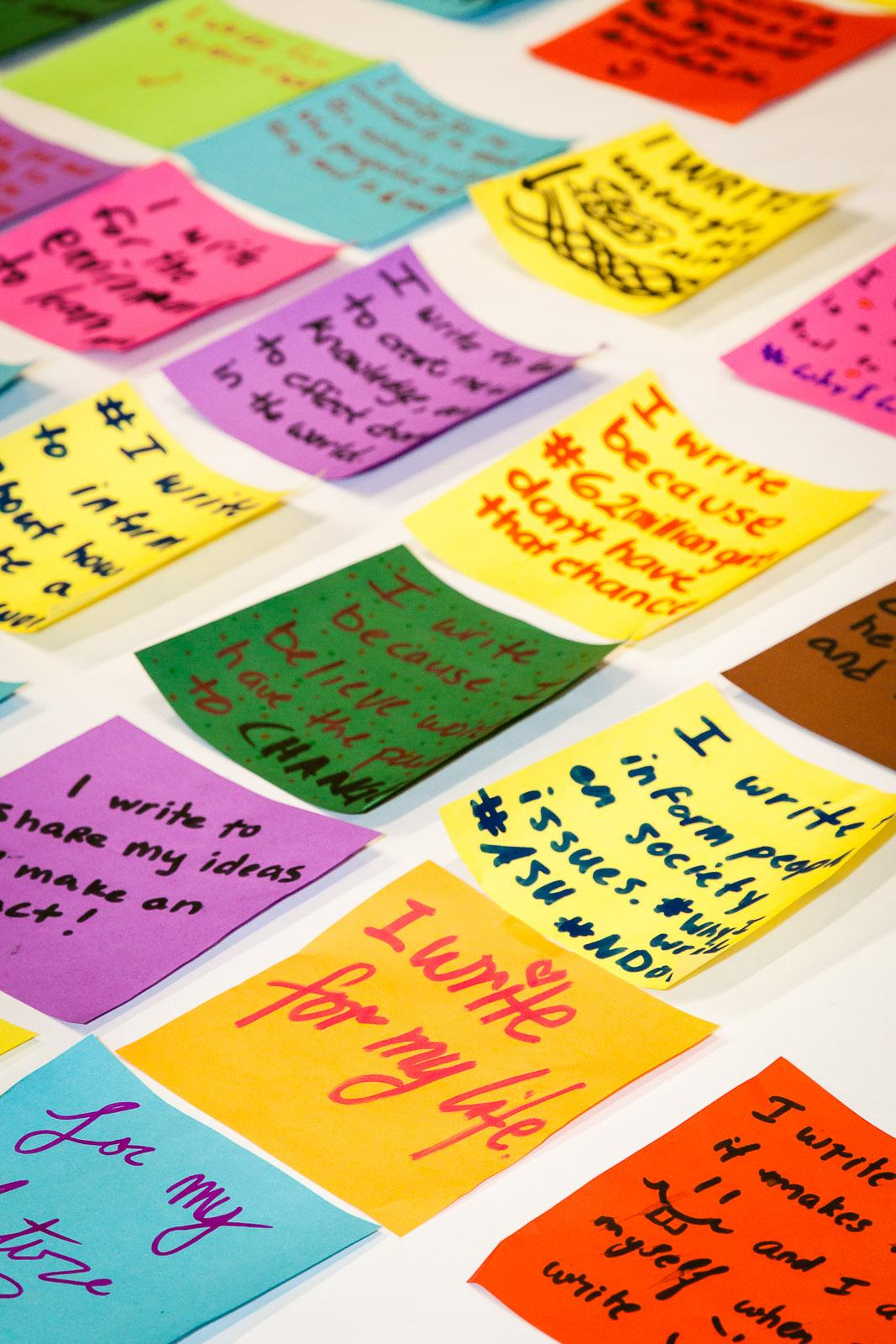 "Image: Participants in ASU's celebration of the 2015 National Day on Writing articulated their thoughts on ""Why I Write"" on squares of origami paper, which were later assembled in a colorful ""quilt."" / Photo by Bruce Matsunaga."
